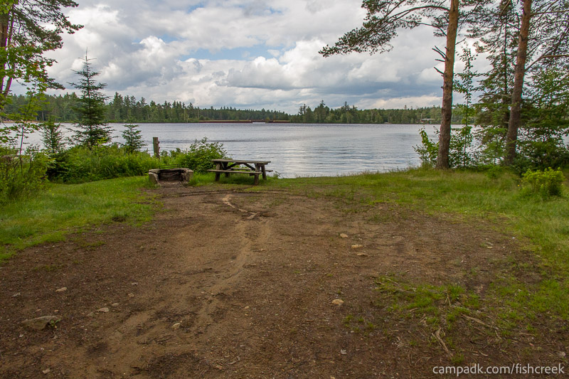 Campsite Photo of Site 282 at Fish Creek Pond Campground, New York - Looking at Site from Part Way In