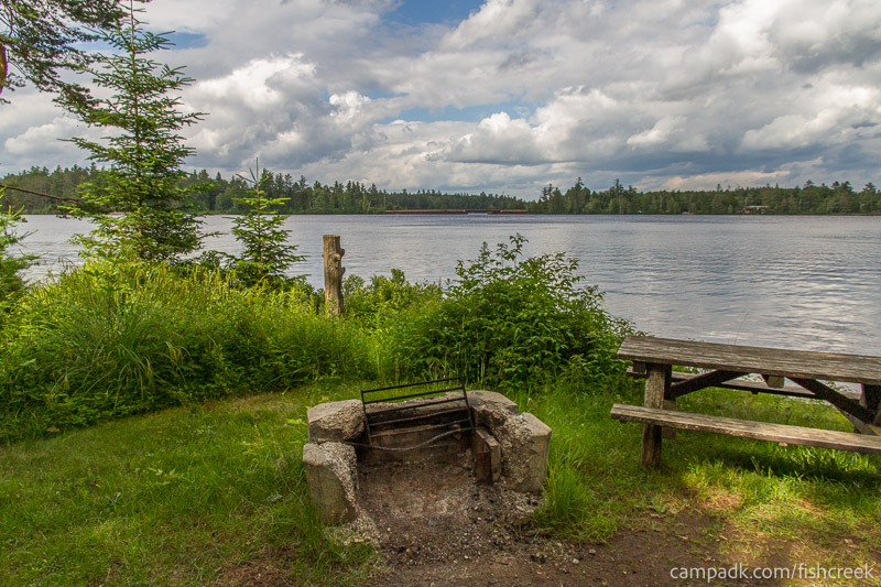 Campsite Photo of Site 282 at Fish Creek Pond Campground, New York - Fireplace View