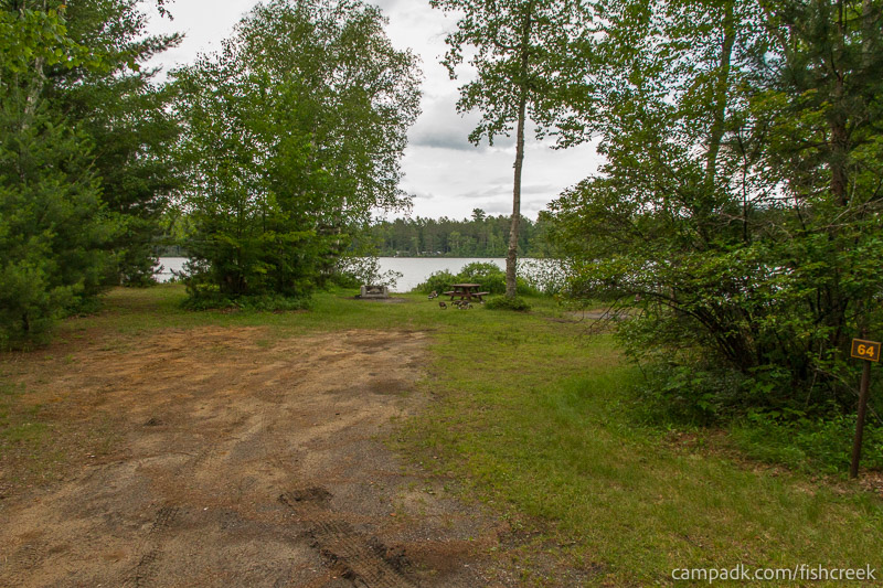 Campsite Photo of Site 64 at Fish Creek Pond Campground, New York - Looking at Site from Road Sign Visible