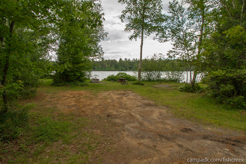 Campsite Photo of Site 64 at Fish Creek Pond Campground, New York - Looking at Site from Road