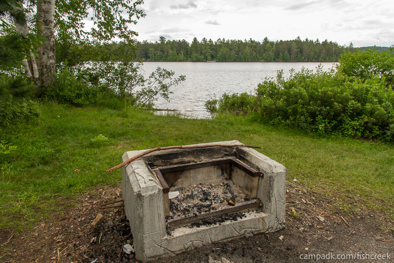Campsite Photo of Site 64 at Fish Creek Pond Campground, New York - Fireplace View