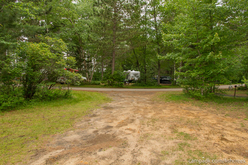 Campsite Photo of Site 64 at Fish Creek Pond Campground, New York - Looking Back Towards Road