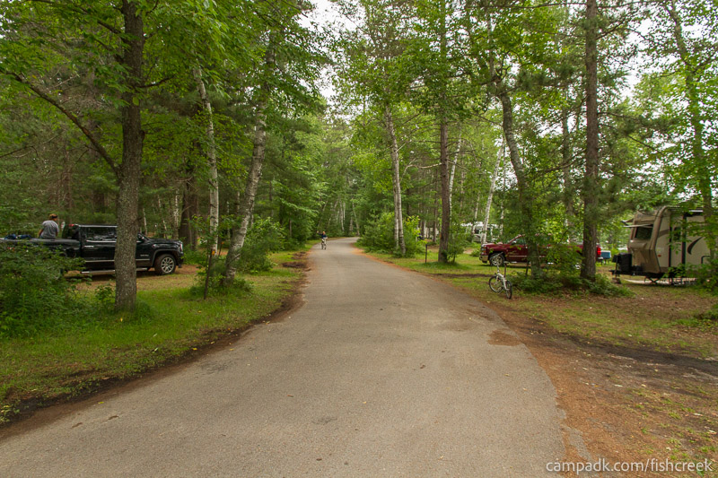 Campsite Photo of Site 64 at Fish Creek Pond Campground, New York - View Down Road from Campsite