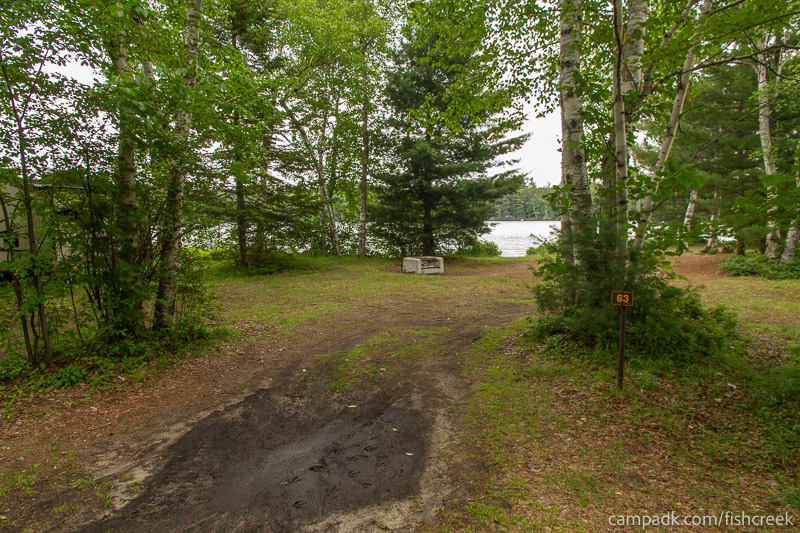 Campsite Photo of Site 63 at Fish Creek Pond Campground, New York - Looking at Site from Road Sign Visible
