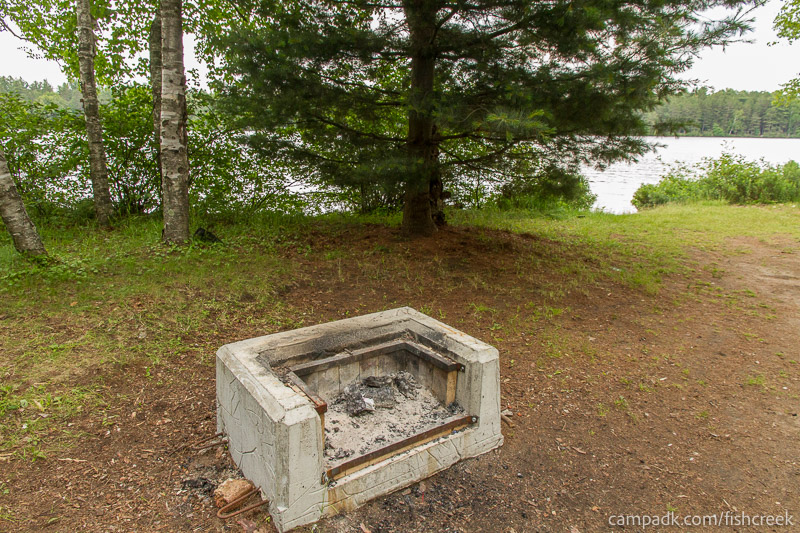 Campsite Photo of Site 63 at Fish Creek Pond Campground, New York - Fireplace View