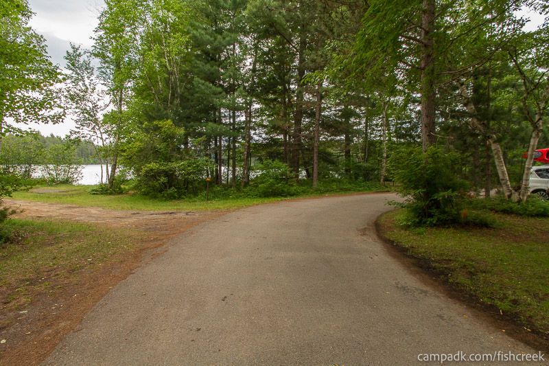Campsite Photo of Site 63 at Fish Creek Pond Campground, New York - View Down Road from Campsite