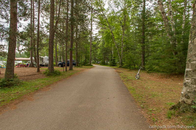 Campsite Photo of Site A7 at Fish Creek Pond Campground, New York - View Down Road from Campsite