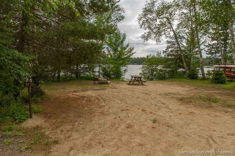 Campsite Photo of Site 52 at Fish Creek Pond Campground, New York - Looking at Site from Road Sign Visible