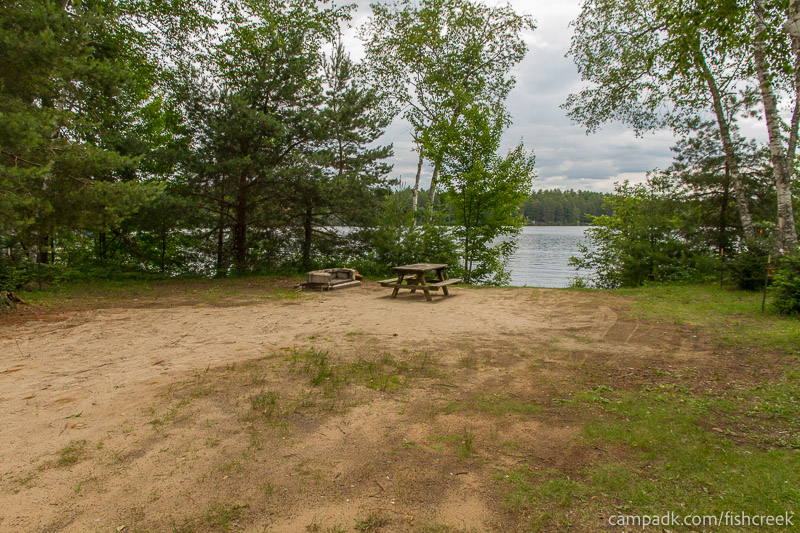Campsite Photo of Site 52 at Fish Creek Pond Campground, New York - Looking at Site from Road