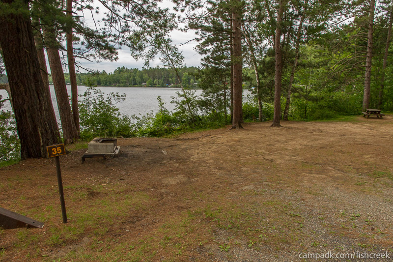 Campsite Photo of Site 35 at Fish Creek Pond Campground, New York - Looking at Site from Road Sign Visible