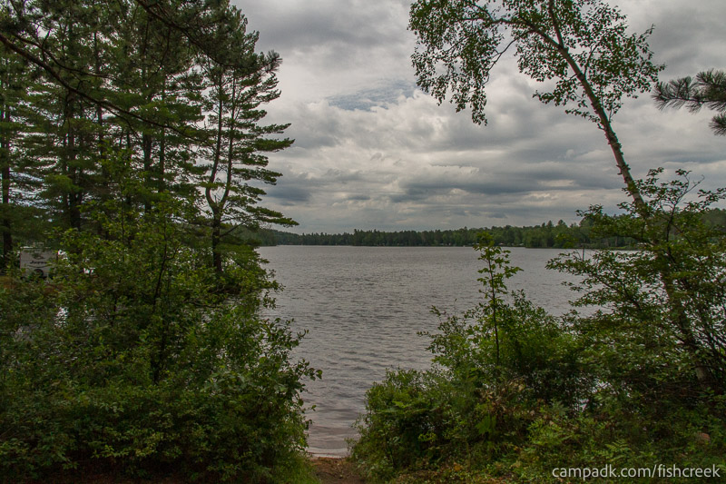Campsite Photo of Site 35 at Fish Creek Pond Campground, New York - Shoreline and View