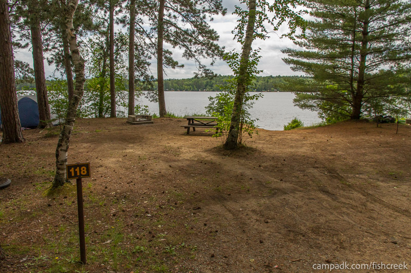 Campsite Photo of Site 118 at Fish Creek Pond Campground, New York - Looking at Site from Road Sign Visible