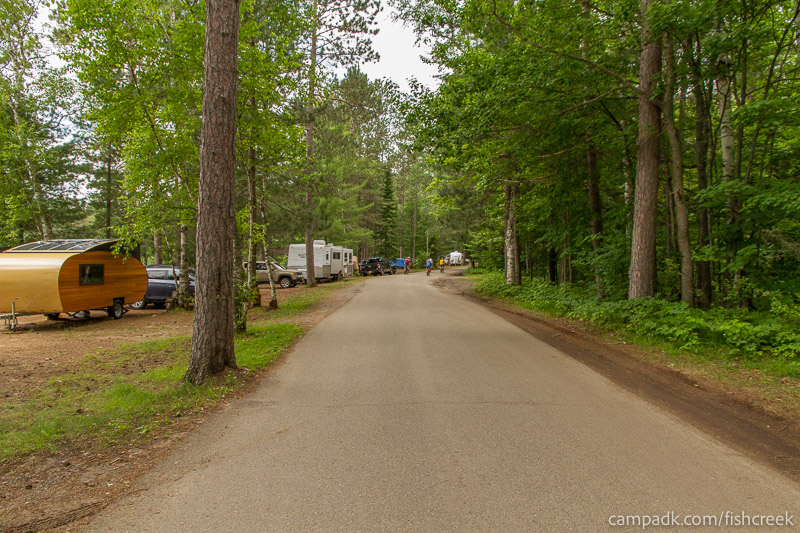 Campsite Photo of Site 118 at Fish Creek Pond Campground, New York - View Down Road from Campsite