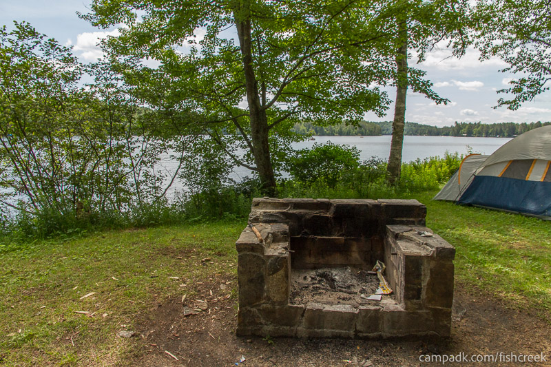 Campsite Photo of Site 41 at Fish Creek Pond Campground, New York - Fireplace View