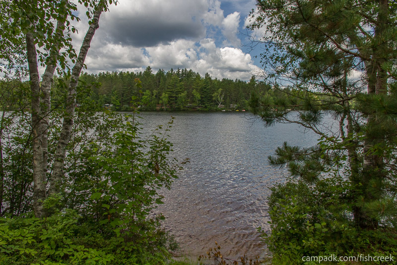 Campsite Photo of Site 185 at Fish Creek Pond Campground, New York - View from Shoreline