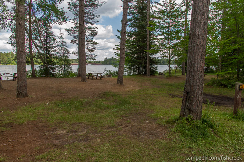 Campsite Photo of Site 278 at Fish Creek Pond Campground, New York - Looking at Site from Road Sign Visible