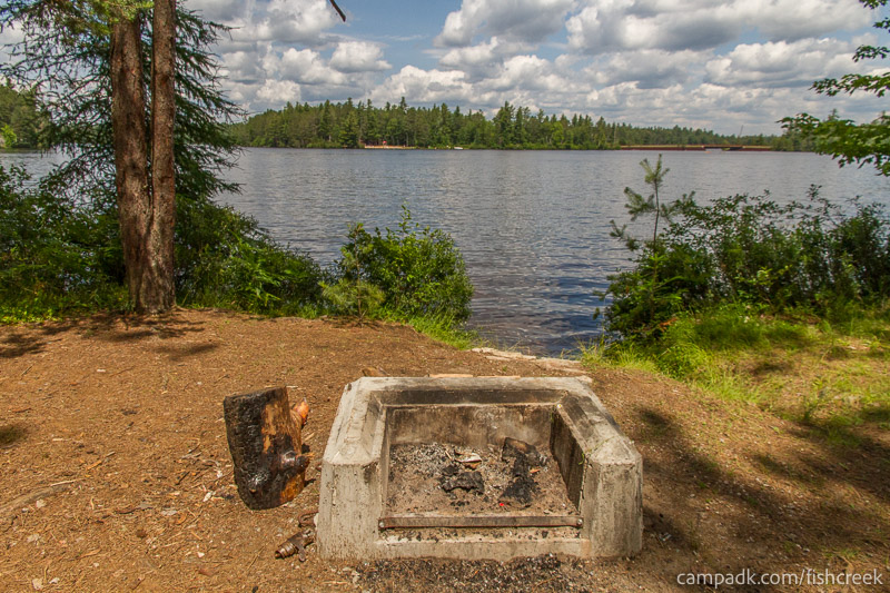 Campsite Photo of Site 278 at Fish Creek Pond Campground, New York - Fireplace View