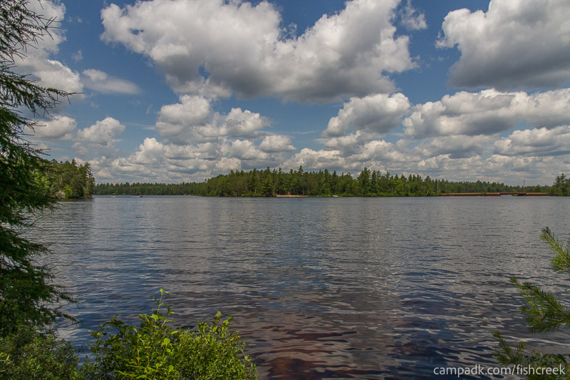 Campsite Photo of Site 278 at Fish Creek Pond Campground, New York - View from Shoreline