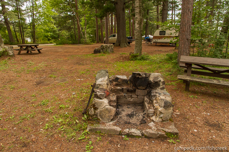 Campsite Photo of Site A10 at Fish Creek Pond Campground, New York - Fireplace View