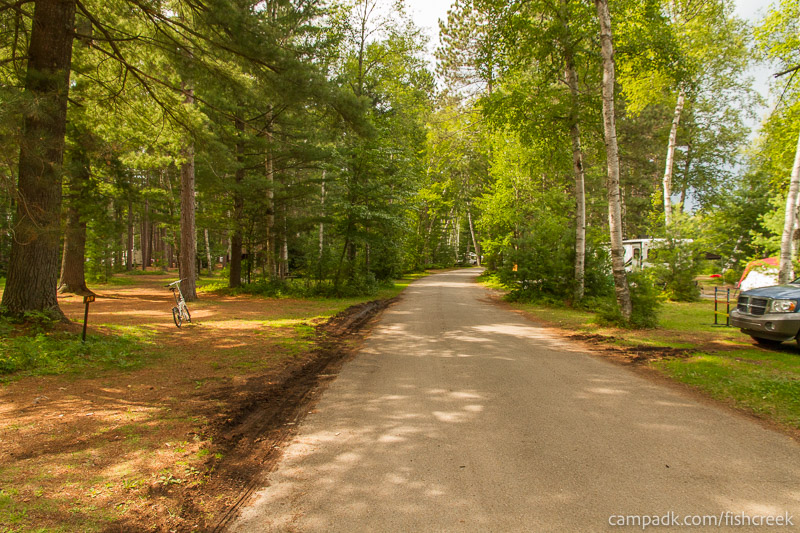 Campsite Photo of Site A10 at Fish Creek Pond Campground, New York - View Down Road from Campsite