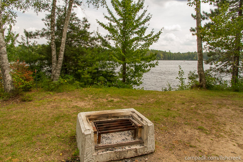 Campsite Photo of Site 53 at Fish Creek Pond Campground, New York - Fireplace View