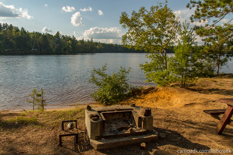 Campsite Photo of Site 186 at Fish Creek Pond Campground, New York - Fireplace View