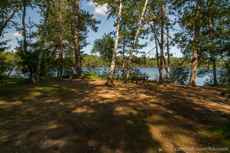 Campsite Photo of Site 57 at Fish Creek Pond Campground, New York - Looking at Site from Road