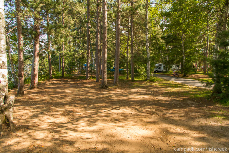 Campsite Photo of Site 57 at Fish Creek Pond Campground, New York - Cross Site View