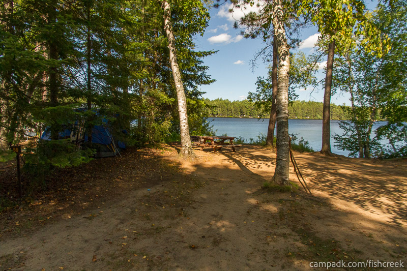 Campsite Photo of Site 56 at Fish Creek Pond Campground, New York - Looking at Site from Road Sign Visible