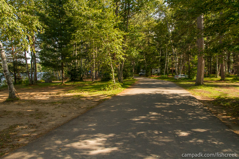Campsite Photo of Site 56 at Fish Creek Pond Campground, New York - View Down Road from Campsite