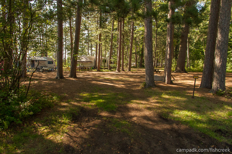 Campsite Photo of Site A12 at Fish Creek Pond Campground, New York - Looking at Site from Road Sign Visible