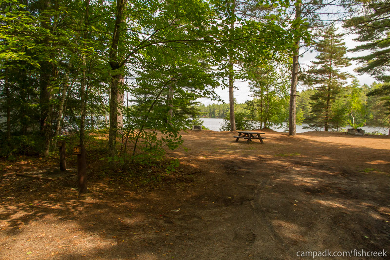 Campsite Photo of Site 249 at Fish Creek Pond Campground, New York - Looking at Site from Road Sign Visible