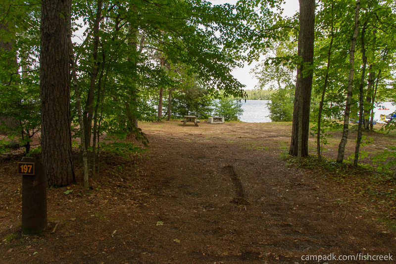 Campsite Photo of Site 197 at Fish Creek Pond Campground, New York - Looking at Site from Road Sign Visible
