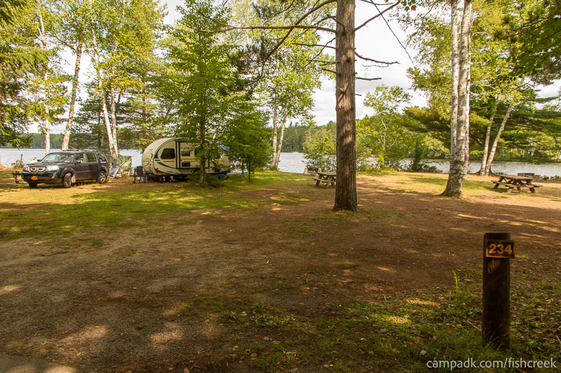 Campsite Photo of Site 234 at Fish Creek Pond Campground, New York - Looking at Site from Road Sign Visible