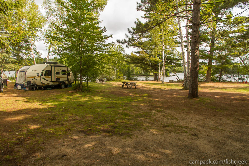 Campsite Photo of Site 234 at Fish Creek Pond Campground, New York - Looking at Site from Road