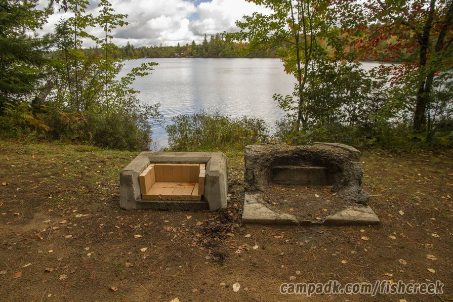 Campsite Photo of Site 303 at Fish Creek Pond Campground, New York - Fireplace View (New)