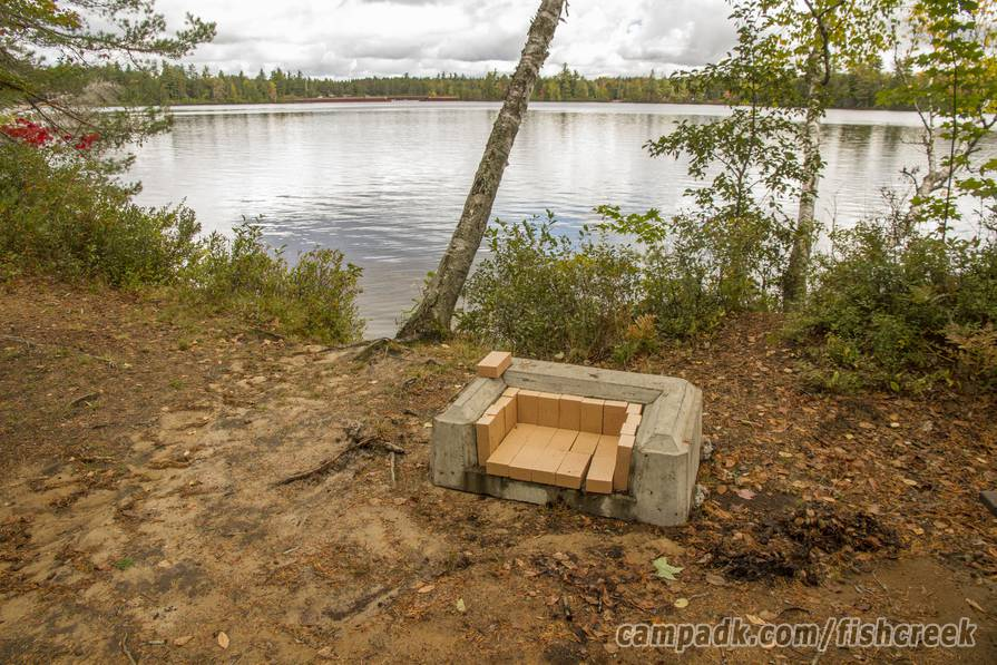 Campsite Photo of Site 294 at Fish Creek Pond Campground, New York - Fireplace View (New)