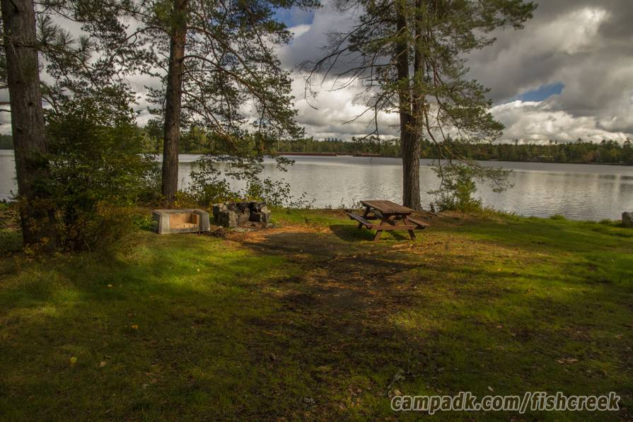 Campsite Photo of Site 285 at Fish Creek Pond Campground, New York - Fireplace View (New)