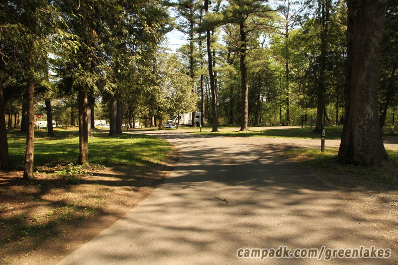 Campsite Photo of Site P64 at Green Lakes State Park, New York - View Down Road from Campsite