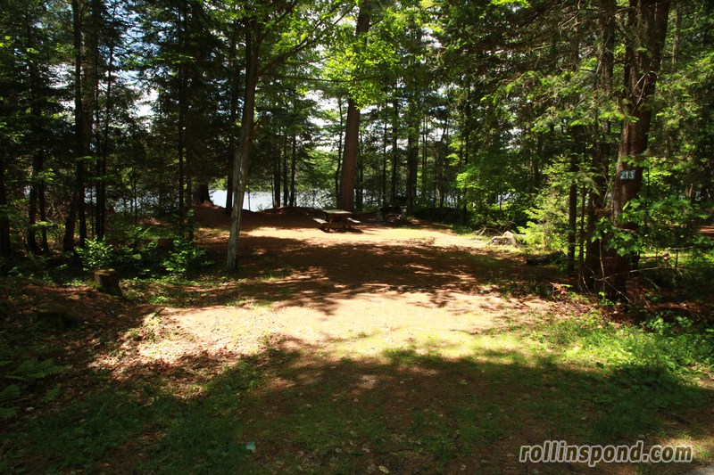 Campsite Photo of Site 213 at Rollins Pond Campground, New York - Looking at Site from Road Sign Visible
