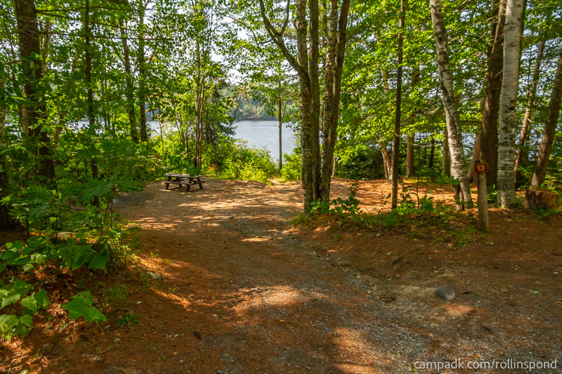 Campsite Photo of Site 13 at Rollins Pond Campground, New York - Looking at Site from Road Sign Visible